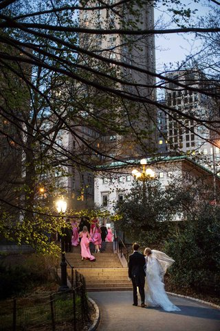 bride-and-groom-walk-up-steps-to-nyc-hotel-from-central-park
