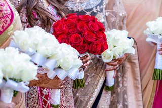 bride-and-bridesmaid-bouquet-with-red-and-white-roses