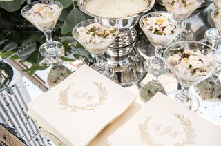 wedding-cocktail-hour-monogram-beverage-napkins-next-to-hors-doeuvres-in-cocktail-glasses