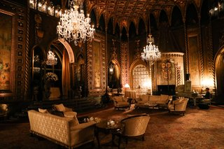 wedding-reception-lounge-area-piano-player-chandelier-opulent-decor