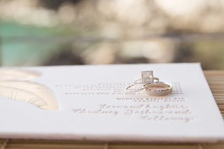 princess-cut-engagement-ring-with-square-halo-diamond-wedding-band-mens-band-on-invitation-feather