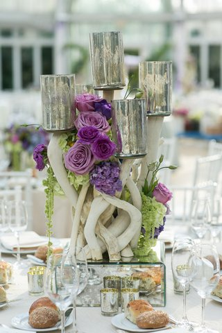 driftwood-and-purple-flowers-on-mirror-box-with-candle-votives