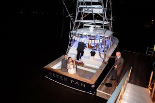 bride-and-groom-leave-reception-on-boat