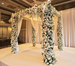chuppah-with-floral-columns-and-canopy-with-drapery-accents