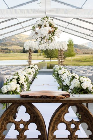 outdoor-tent-wedding-aspen-colorado-ranch-with-wood-slab-on-church-table-for-guest-book-display