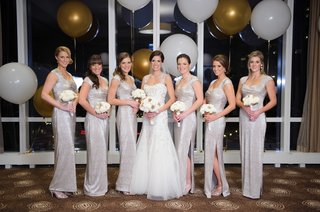 bride-in-monique-lhuillier-bridesmaids-in-silver-ralph-lauren-gowns-new-years-eve-wedding