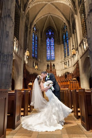 groom-dipping-bride-for-kiss-in-pittsburgh-church