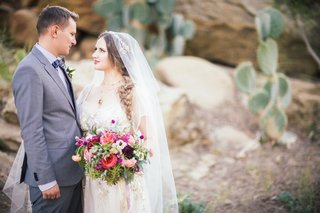 boho-bride-with-braid-and-vintage-wedding-veil