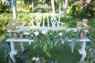 vintage-sweetheart-table-and-chairs-mercury-glass-candleholders-greenery-white-roses-in-reception