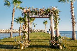 destination-wedding-in-cabo-san-lucas-chuppah-with-peach-flowers-gold-lanterns