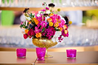 flower-arrangement-with-pink-and-orange-roses-in-gold-glitter-vase