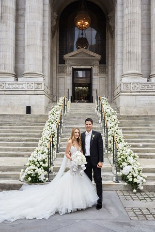 bride-in-galia-lahav-wedding-dress-cathedral-veil-groom-tux-white-bow-tie-new-york-library-steps