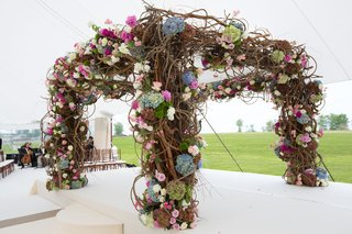 chuppah-with-pink-blue-and-green-hydrangeas-with-lots-of-branches