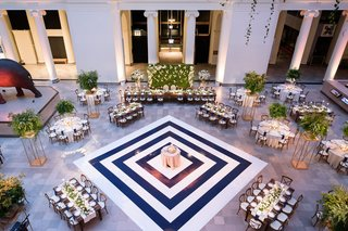 wedding-reception-at-the-field-museum-in-chicago-navy-white-stripe-dance-floor-cake-in-center