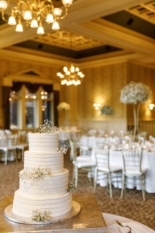 four-tier-wedding-cake-with-sprigs-of-babys-breath