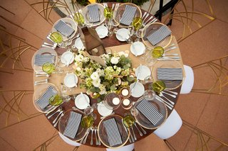 wood-reception-table-with-striped-napkins-and-green-glasses