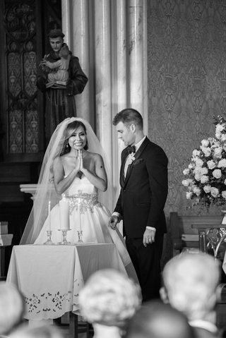 black-and-white-photo-of-bride-in-alyne-ball-gown-and-groom-in-tuxedo-with-unity-candle
