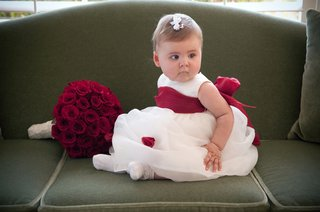 baby-flower-girl-with-big-red-bow-on-white-dress