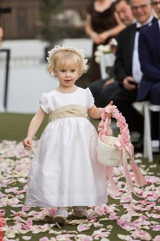 young-flower-girl-with-white-dress-tan-sash-flower-crown-basket-with-pink-handle