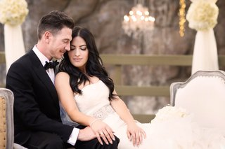 bride-in-vera-wang-groom-in-armani-collezioni-newlyweds-sit-together-after-ceremony
