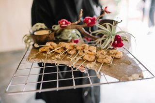 shrimp-on-toothpicks-with-dipping-sauce-at-wedding