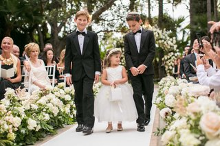 groomsmen-in-bow-tie-and-yarmulke-with-flower-girl-and-flower-girl-basket-white-flower-crown-guests