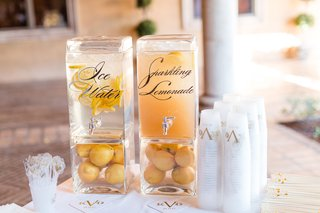 monogram-on-plastic-cups-drink-dispensers-with-calligraphy-ice-water-and-sparkling-lemonade-clear