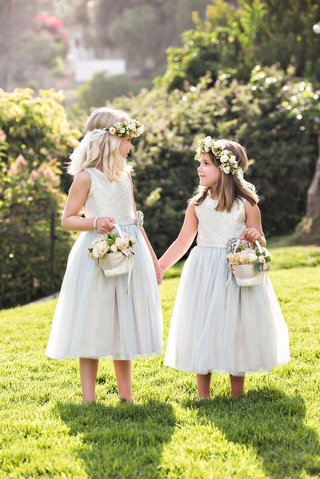 flower-girl-in-tank-dress-tulle-skirt-basket-with-flowers-and-flower-crowns-halos-blonde-hair