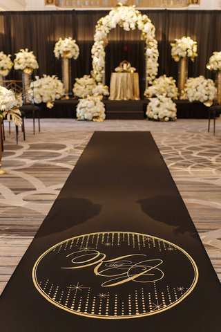 black-aisle-with-gold-logo-and-monogram-aisle-runner-by-original-runner-company