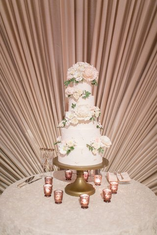 wedding cake five layer round white cake sugar flower peony rose gold candles wall drapes