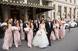 bride-groom-bridesmaids-groomsmen-walk-across-new-york-street-together