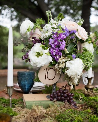 table-number-etched-on-a-piece-of-wood-on-white-and-purple-flowers