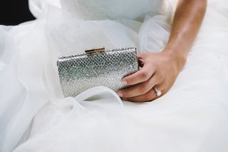 bride-holding-structured-purse-with-snakeskin-design