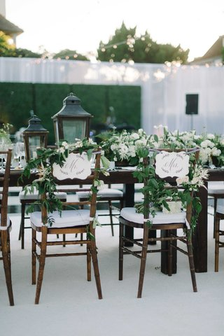 mr-and-mrs-signs-wooden-chairs-vines-lanterns-tables-california-outdoor-reception-beach