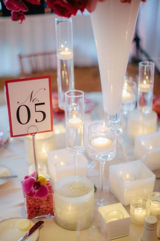 printed-table-number-with-fuchsia-border-in-rock-vase