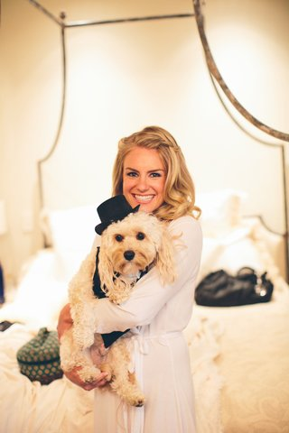 bride-holding-puppy-wearing-tuxedo-and-hat
