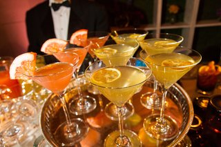 martini-glasses-with-colorful-drinks-and-garnish