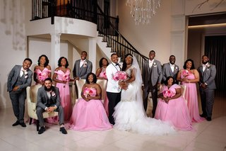 bride-in-mermaid-dress-groom-in-white-tuxedo-bridesmaids-in-pink-mismatch-dresses-groomsmen-in-grey