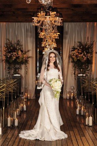 bride-in-oscar-de-la-renta-lace-sheath-gown-with-ruffled-organza-train
