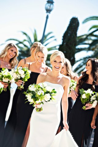 classic-wedding-bride-and-bridesmaids-black-bridesmaid-dresses-greenery-white-bouquets