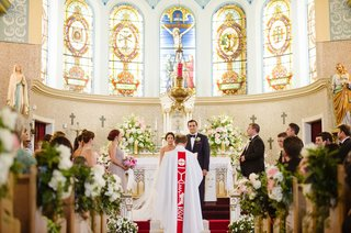 traditional-wedding-ceremony-pretty-church-greenery-white-flowers-on-pews-bridesmaids-groomsmen