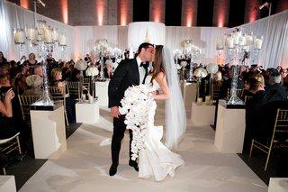 chad-carroll-kisses-jennifer-stone-at-wedding-ceremony-bride-wears-oscar-de-la-renta-orchid-bouquet