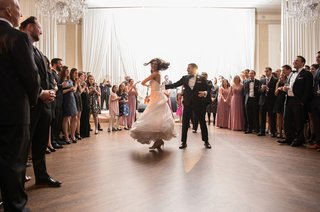 bride-in-essence-of-australia-wedding-dress-groom-in-bonobos-tux-twirl-on-dance-floor