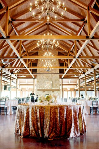 wedding-place-card-table-covered-in-gold-sequined-tablecloth-at-the-pavilion-at-orchard-ridge-farms