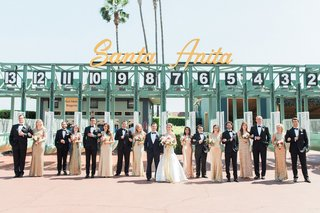 wedding-party-bridesmaids-in-gold-sequin-dresses-and-groomsmen-in-suits-at-santa-anita-racetrack