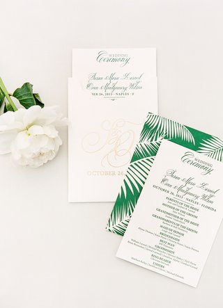 wedding-programs-with-green-palm-frond-graphic-in-envelopes-with-golden-monogram