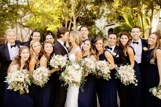 bridesmaids-in-navy-dresses-and-groomsmen-in-tuxedos-at-houston-astros-pitcher-gerrit-cole-wedding