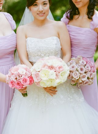 bride-and-bridesmaid-bouquets-in-different-shades-of-pink