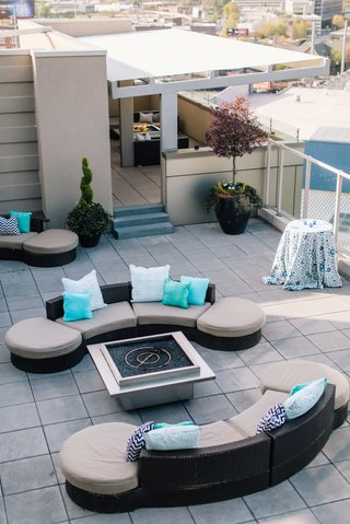 detriot-lions-quarterback-matthew-stafford-rehearsal-dinner-outdoor-rooftop-couches-blue-pillows