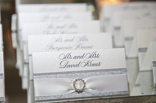 silver-seating-card-with-white-ribbon-and-brooch